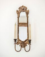Antique candle sconce with integrated mirror