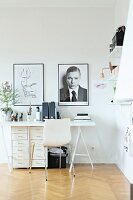 White, Scandinavian engineered wood chair at desk with filing cabinets below