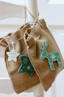 Hand-sewn hessian bags decorated with star and moose motifs
