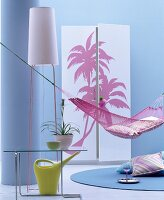 Hammock, standard lamp and wardrobe with palm-tree motifs on front