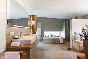 A spacious bathroom with elegant fittings in natural colours