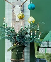 Christmas arrangement in shades of green with bouquet of conifer branches