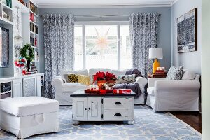 Vintage table on pale blue patterned rug in living room decorated with Advent
