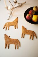 Gingerbread wolves, lit candles in candelabra and fruit bowl