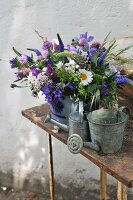 Blue and white summer bouquet and zinc watering can on table