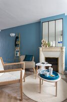 Traditional fire surround in Scandinavian interior with blue-painted walls