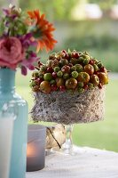Autumnal flower arrangement on table outside