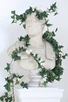 Roman-style bust raped with ivy tendrils