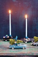 Toy cars as candle holders for Christmas decorations