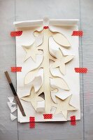 A paper garland being cut out