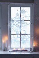 Christmas paper stars as window decoration
