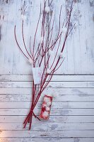Snowflakes made from effect yarn hanging on a red twig