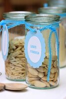 Almonds in storage jars with hand-crafted labels
