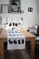 Modern Easter table decorated with rabbit motifs in black and white