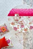 Hot pink as modern accent amongst feminine floral patterns on round table