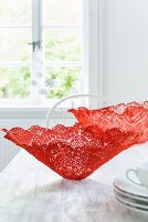 Homemade decorative bowls made from red lace