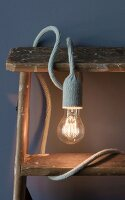 A knitted cable holder for a light bulb