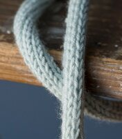 Homemade knitted cable protector for a light bulb (close up)