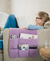 A homemade, knitted living room tidy made from felt wool