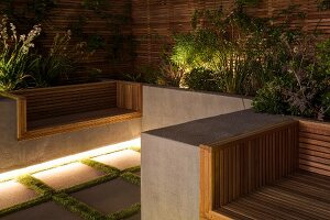Modern seating area on terrace with integrated planters, indirect lighting and wooden screens