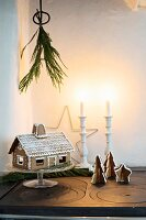 Gingerbread house and gingerbread trees on top of old cooker