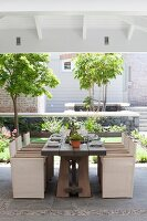 Set table on roofed terrace