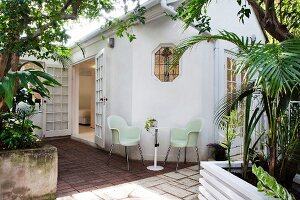 Shady seating area on terrace and open lattice door