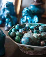 Collection of blue semiprecious stones, snail shell and carved mouse