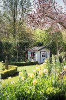 Small playhouse in spring garden