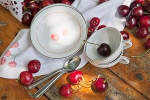 Crockery and napkin printed with patterns of cherries