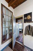 View into vintage-style apartment through door and lattice window