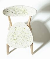 Wooden chair revamped with green splashes of paint