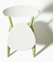 Wooden chair revamped with green-painted legs