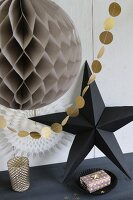Paper Christmas decorations with origami star and garland