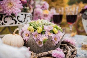 Chrysanthemums on autumnal table