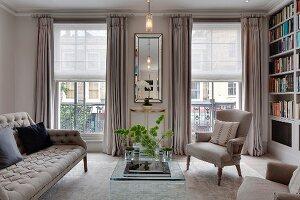 Pale upholstered seating in elegant living room