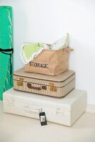 Cushions and cloths in bag on top of stacked suitcases