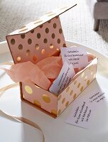 DIY – a cardboard box decorated with shiny paper