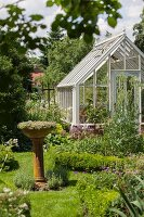 Victorian greenhouse in idyllic garden