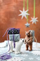 Tiny gifts tied to bear ornaments