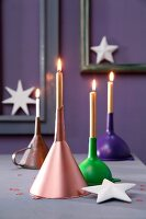 Upturned funnels used as candlesticks
