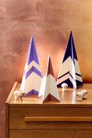 Stylised Christmas trees made from painted plywood