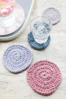 Pastel crocheted coasters