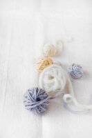 Several balls of yarn in various pastel shades