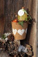 Bottle in papier mâché plant pot as a gift