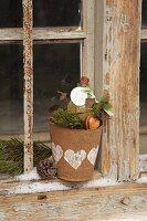 Bottle in papier mâché plant pot decorated as a gift