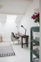 Old wooden bench used as desk in attic room