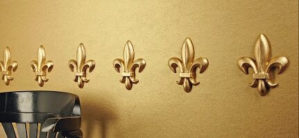 Row of elegant, gold mouldings on wall