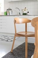 Scandinavian chairs in white kitchen