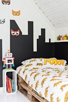 Teenager's attic bedroom with bed on pallets